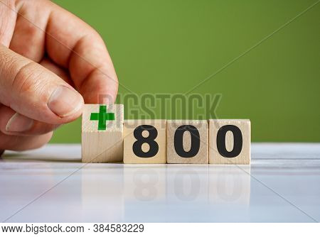 The Hand Turn Wooden Block With Plus Sign And Set Text \