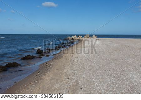 Cape Kolka - The Meeting Place Of The Baltic Sea And The Gulf Of Riga, Latvia. Ruins Of Old Lighthou