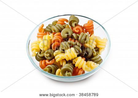 Trottole Tricolore Raw Pasta In Transparent Bowl With Clipping Path