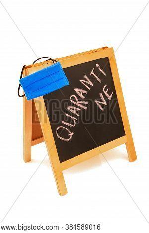 Coronavirus Concept With Text Quarantine, Announcement On Wooden Board, Blackboard, Chalkboard, Fram