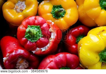 Close-up Red And Yellow Bell Peppers Stuffed With Meat. Stuffed Peppers With Minced Meat. Stuffed Pa