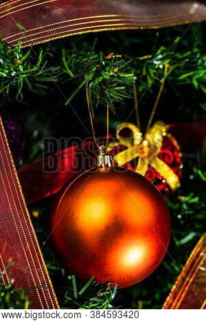 Christmas Hanging Decorations On Fir Tree. Decorated Christmas Tree. Fir Branch With Christmas Baubl