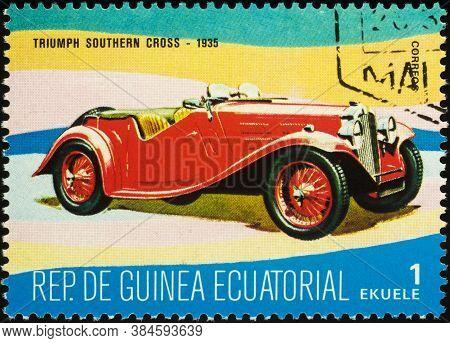Moscow, Russia - September 09, 2020: Stamp Printed In Equatorial Guinea Shows British Retro Car Triu