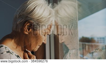 Hopeless Elderly Woman, Feeling Loneliness During The Lockdown. Vulnerable Group And Mental Health I