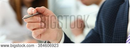 Focus On Male Hand Holding Writing Pen And Wearing Classy Suit And Striped Tie. Smart People Talking