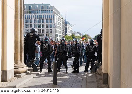 Berlin, Germany - August 29, 2020: Police Men Blocking The Brandenburg Gate During A Demonstration
