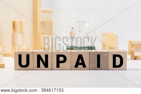 Unpaid Word On Wood Blocks Concept. Business Concept