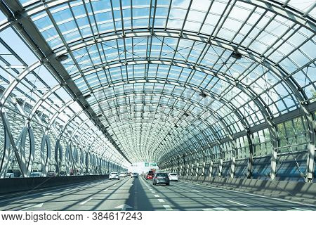Poland. Warsaw. 06.07.2019 A View Of The Autobahn With Driving Cars Under The Soundproof Metal Struc