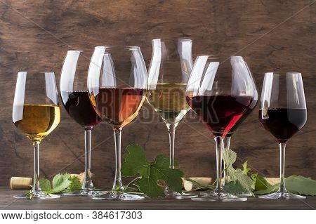Wine Set. Red, White And Rose Wine In Assortment In Wineglasses. Wine Tasting, Vintage Wooden Backgr