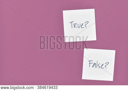White Sticky Notes With Words 'true?' And 'false?' On Purple Background