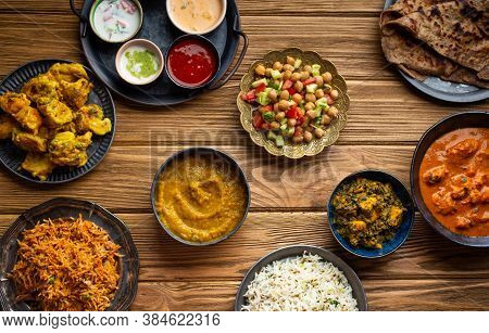 Assorted Indian Home Food, Different Dishes And Snacks On Wooden Rustic Table. Homemade Pilaf, Butte