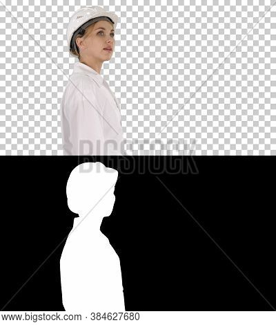 Young Woman In Hard Hat Walking And Looking Around, Alpha Channel