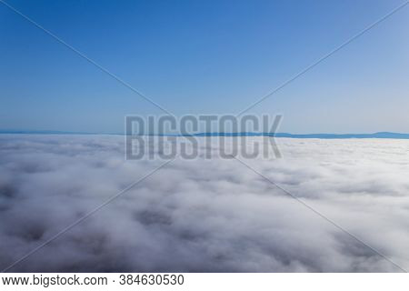 Hot air balloon in the Alentejo region, above the clouds. Portugal.