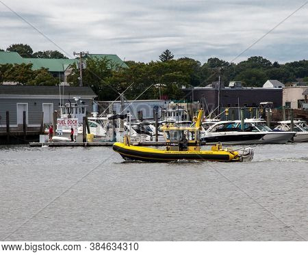 NORWALK, CT, USA - AUGUST 7, 2020: Yellow towing boat on Norwalk River