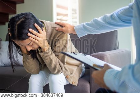 Psychologists Or Doctors Treat Psychological Symptoms, Touch The Shoulder Of Female Patients With St