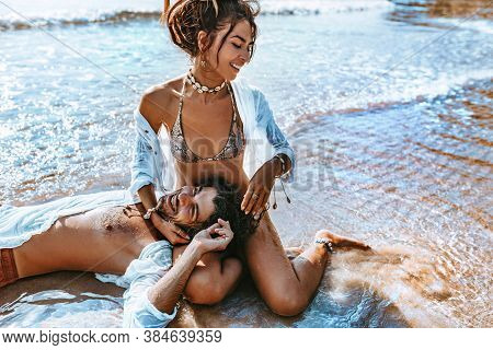 Close Up Of Beautiful Young Couple Having Fun At The Beach