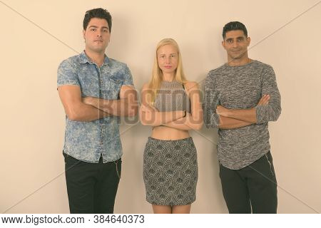 Three Multi-ethnic Friends Together Against White Background