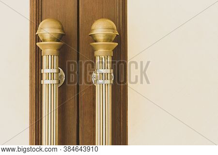Vintage Gold Door Handle Front Side Of Entrance Interior Home. Close-up Closed Light Wooden Doors In