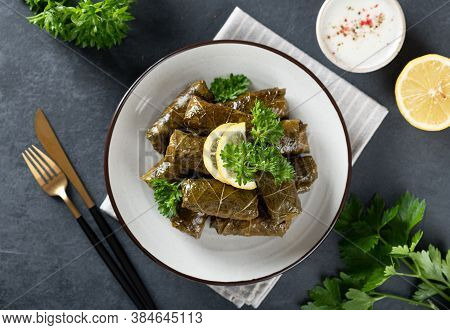 Dolma On A Dark Background. Traditional Caucasian, Turkish And Greek Cuisine, Top View