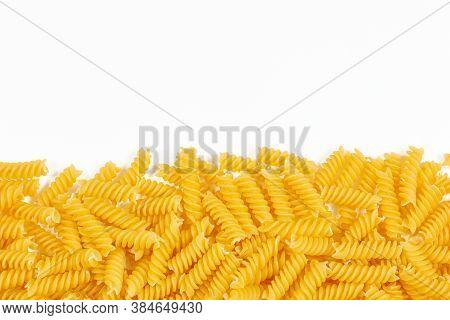 Uncooked Fusilli Pasta Noodles On White Background. Italian Pasta Border For Menu Design Template, F