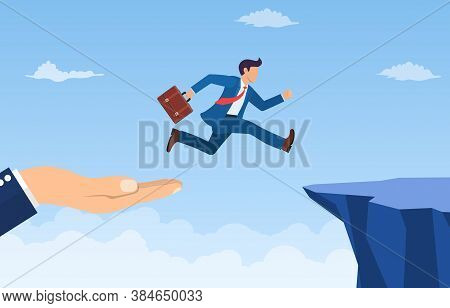 Hand Helping Businessman Jump Through The Gap In The Rocks. An Employee With A Running Jump From One