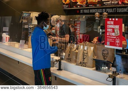 Angers, France - September 09 2020: People Wearing Face Protective Mask In Fast Food Cafe At France