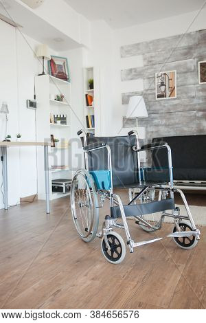 Wheelchair In Healthcare Room For Patients With Walking Illness. No Patient In The Room In The Priva