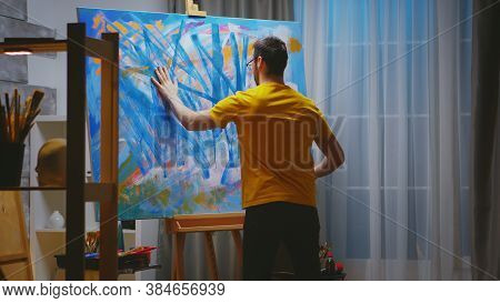 Impressionism Painter In Art Studio Painting With Fingers On Large Canvas.