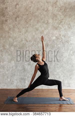 Yogi Mid Aged Woman Practicing Yoga, Looking Up, Standing In Reverse Warrior Pose, Virabhadrasana Ex