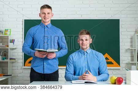 Two Teenage Boys Twins In School Dress With Books. Brother Support. Twin Boys In Uniform On Lesson.