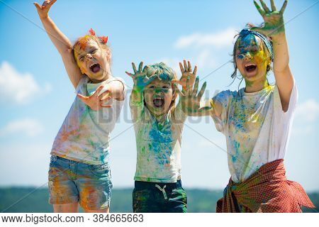 Portrait Of A Beautiful Kids Showing Colorful Colored Hands. Happy Childhood. Emotional Cheerful Exc