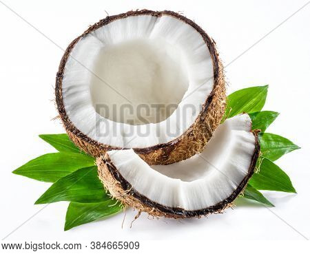 Split coconut fruit with coconuts leaves isolated on white background.