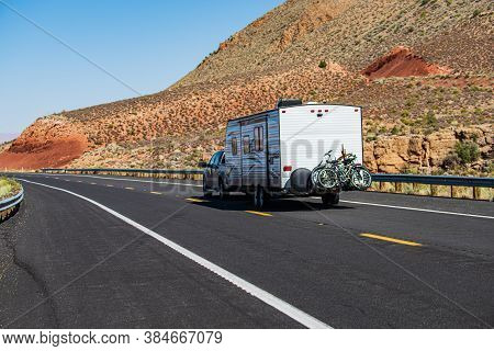 Mohave Desert By Route 66. Rv Camping, Camper Van On Road. Caravan Or Recreational Vehicle Motor Hom