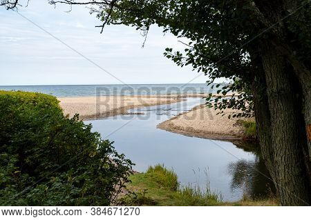 The River Enters The Sea At A Calm Beach In Haväng,