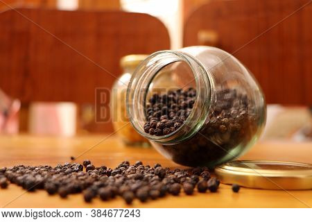 Glass Jar With Black Pepper On The Wooden Background,  Black Pepper Is Scattered On Wood, Spices On
