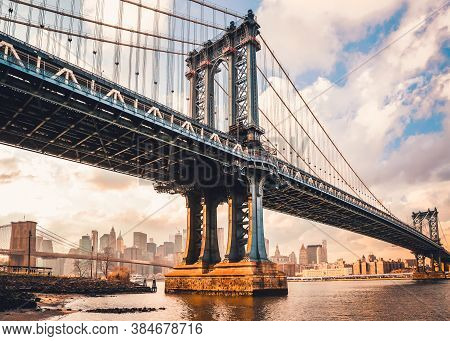 Manhattan Bridge Over East River At Sunset In New York City, Usa. Beautiful Skyline With Skyscrapers