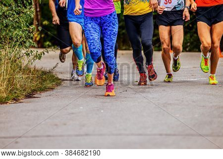 Group Leg Runners Women And Men Run Race On Road In Park