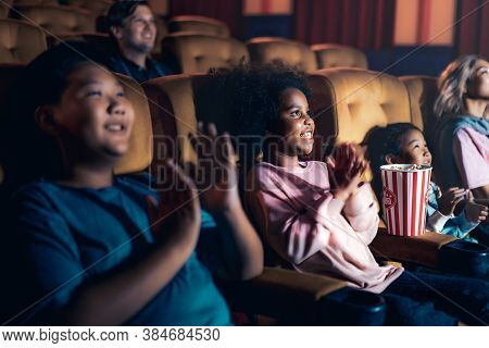 People Audience Watching Movie In The Movie Theater Cinema. Group Recreation Activity And Entertainm