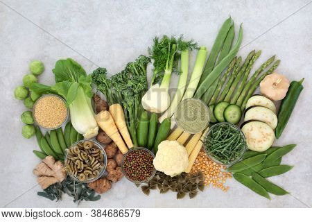 Vegan green & yellow health foods for immune defense with high nutritional values with antioxidants, minerals, vitamins, dietary fibre & smart carbs. With vegetables, legumes, pasta, grains & spice.