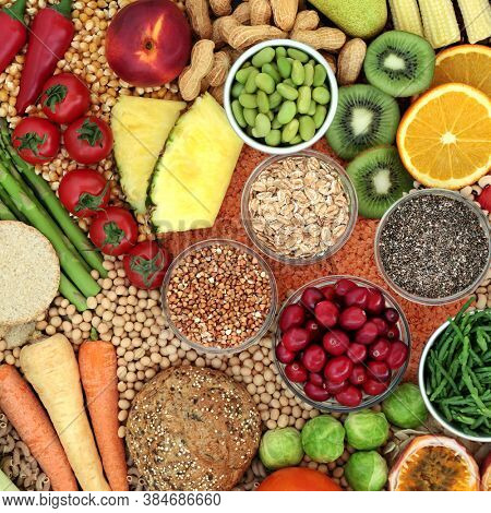 Healthy high fibre food collection for good digestive health with foods also high in antioxidants, minerals, vitamins, anthocyanins, omega 3, protein, carotenoids & lycopene. Healthcare concept.