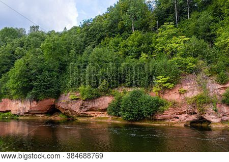 Landscape With Sandstone Cliffs On The Gauja River Bank, Fast Flowing And Clear River Water, Kuku Cl