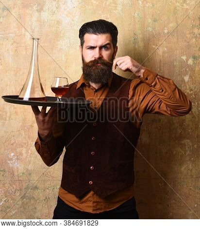 Barman With Confident Face Serves Scotch Or Brandy