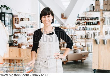 Owner Of Sustainable Small Local Business. Female Seller Assistant Of Zero Waste Shop On Interior Ba