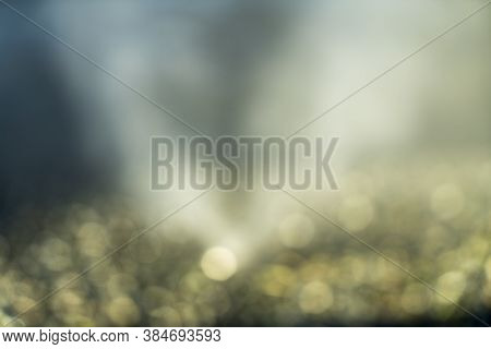 Golden Bokeh Of Water For Backgrounds And Compositions