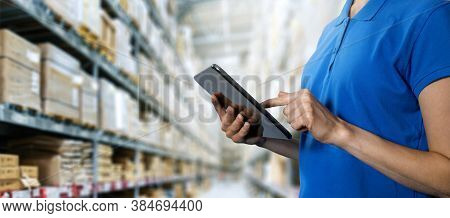 Logistics Service, Warehouse Management And Inventory Concept - Female Worker Using Digital Tablet I