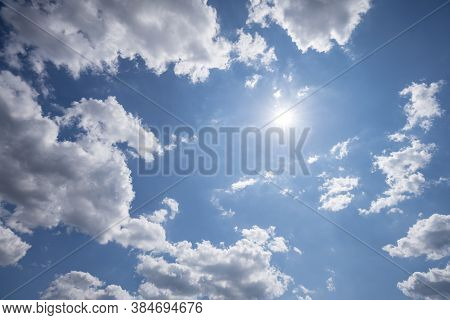 Blue Sky Photographed With Clouds And Sun Upwards