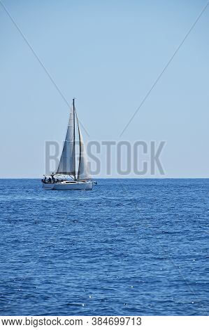 Tranquil Seascape With Calm Sea Water Ripples And Waves And Sail Yacht Under Clear Day Blue Sky, Hig