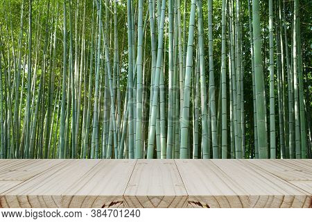 Bamboo Forest Background With Wood Table Photo Montage For Product Display. Background Of Arashiyama