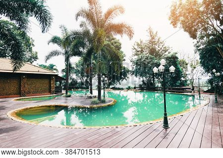 Swimming Pool In Summer Day Vacation With Green And Blue Water / Beautiful House Garden Park With Pa