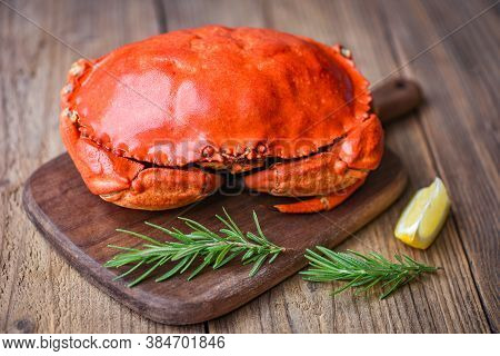 Fresh Crab With Ingredients Lemon Rosemary On Wooden Board / Seafood Shellfish Steamed Red Crab Or B